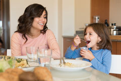 Mom and daughter having lunch Royalty Free Stock Photography