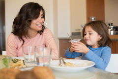 Mom and daughter having lunch Stock Photography