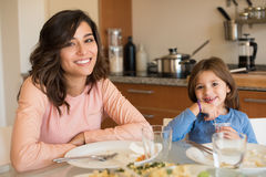 Mom and daughter having lunch Royalty Free Stock Image