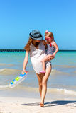 Mom daughter having a walk at the beach Stock Photos