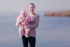 Mom with daughter on her hands. Royalty Free Stock Photos
