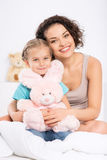 Mom with daughter and her toy Stock Photos
