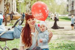 Mom and daughter holding a balloon. In the Park royalty free stock photography