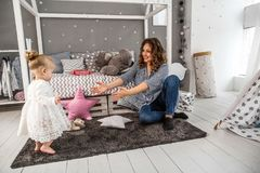 Mom and daughter are at home in the room, Mother`s Day.  Stock Photos