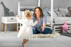 Mom and daughter are at home in the room, Mother`s Day.  Royalty Free Stock Photos
