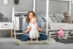 Mom and daughter are at home in the room, Mother`s Day.  Stock Image