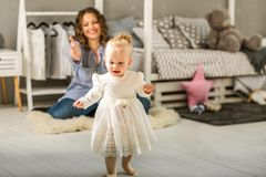 Mom and daughter are at home in the room, Mother`s Day.  Stock Photo