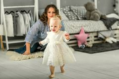 Mom and daughter are at home in the room, Mother`s Day.  Royalty Free Stock Photography