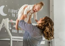 Mom and daughter are at home in the room, Mother`s Day.  Royalty Free Stock Images