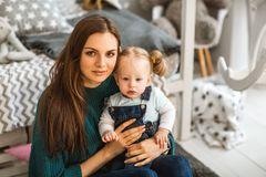 Mom and daughter are at home in the room, Mother`s Day.  Stock Images