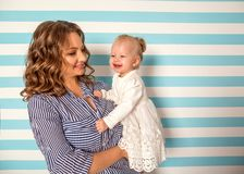 Mom and daughter are at home in the room, Mother`s Day.  Royalty Free Stock Image