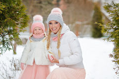 Mom and daughter hugging happy winter in the park royalty free stock photos