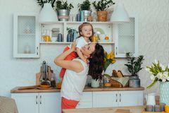 Mom and daughter in the kitchen stock photos
