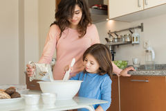 Mom and daughter in kitchen Stock Photo