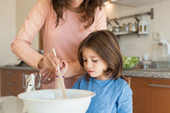 Mom and daughter in kitchen Royalty Free Stock Photo