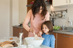 Mom and daughter in kitchen Royalty Free Stock Photography