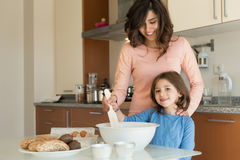Mom and daughter in kitchen Royalty Free Stock Images
