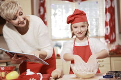 Mom and daughter in the kitchen . Stock Images