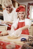 Mom and daughter in the kitchen . Stock Photo