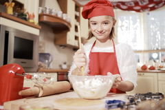 Mom and daughter in the kitchen. Stock Images
