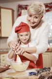 Mom and daughter in the kitchen. Royalty Free Stock Photography