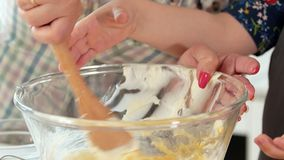 Mom with daughter kneads the dough for homemade baking. Close up stock video