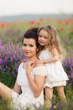 Mom and daughter on a lavender field Royalty Free Stock Photography