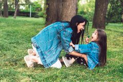 Mom and daughter on the lawn have fun Royalty Free Stock Image