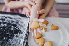 Heart-shaped cookies on the girl`s hand Royalty Free Stock Images
