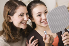 Mom and Daughter with Lipstick Royalty Free Stock Images