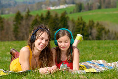 Mom and daughter listening music Royalty Free Stock Photo