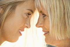 Mom and daughter looking at each other. Stock Image