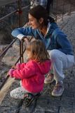 Mom and daughter are looking through the railing royalty free stock photos