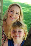 Mom with daughter looking through tree branches Royalty Free Stock Photos