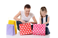 Mom and daughter with lot packages with shopping Stock Image
