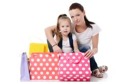 Mom and daughter with lot packages with shopping Stock Images
