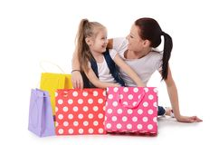 Mom and daughter with lot packages with shopping Royalty Free Stock Photography