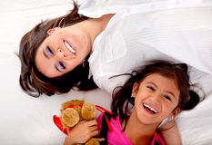 Mom and daughter lying Stock Photo