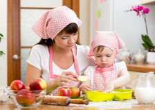Mom and daughter making apple pie together. Mother and daughter making apple pie together Royalty Free Stock Photos