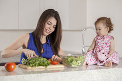 Mom and daughter making dinner Royalty Free Stock Image