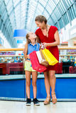 Mom with daughter in mall or store Royalty Free Stock Photo