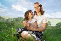 Mom and daughter on a meadow Royalty Free Stock Image