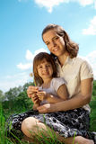 Mom and daughter on a meadow Royalty Free Stock Photos