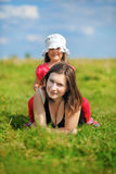 Mom and daughter on a meadow Stock Photos