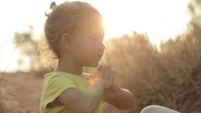 Mom and daughter meditate at sunrise stock footage