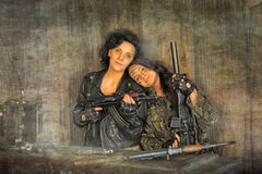 Mom and daughter in the militia Stock Photos