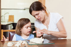 Mom and daughter mold dough figurines Royalty Free Stock Images