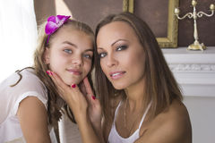 Mom and daughter. Mother holds face girl. Family concept Stock Image