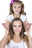 Mom and daughter. Mother holds face girl. Family concept Royalty Free Stock Photo