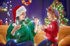 Mom and daughter near the Christmas tree Royalty Free Stock Photography